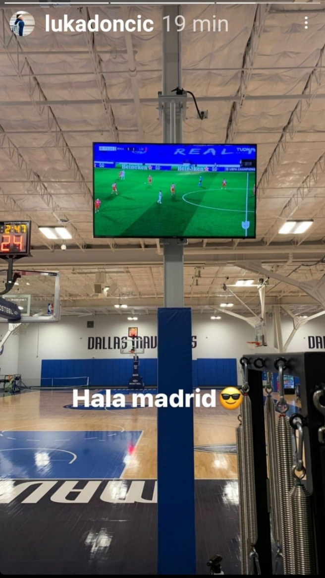 Luka Doncic watches the Real Madrid game while training.