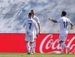 Benzema, Hazard y Asensio celebran un gol.