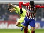 Un lance del partido entre el Atlético de Madrid y el FC Barcelona.