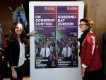 Ione Belarra pega carteles de Unidas Podemos.
