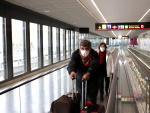 Dos mexicanos tratan de volver a su país.