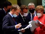 La canciller alemana, Angela Merkel, y el presidente francés, Emmanuel Macron, durante la reunión del Consejo Europeo, en Bruselas.