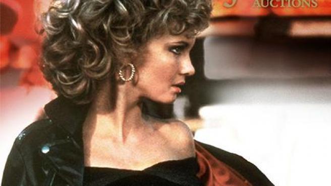 Cartel de la subasta de la ropa de Olivia Newton-John en Grease.