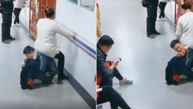 Un hombre hace de silla en el hospital para su mujer embarazada.