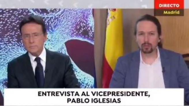Matías Prats y Pablo Iglesias, en el informativo de Antena3.