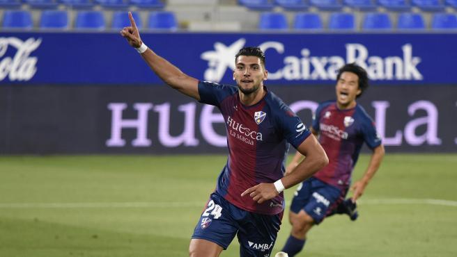 Los jugadores del Huesca celebran un gol ante el Numancia