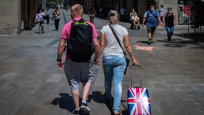 Dos turistas británicos en Barcelona.