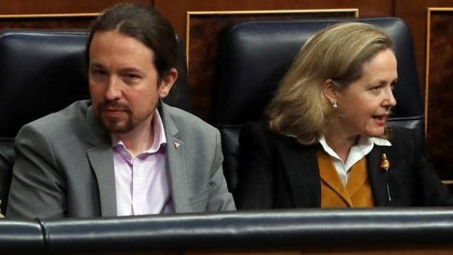 Nadia Calviño y Pablo Iglesias en el Congreso de los Diputados.