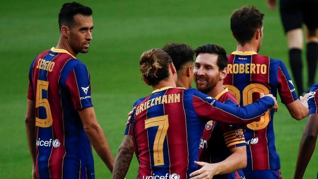Griezmann celebra el tanto de la victoria con Leo Messi.