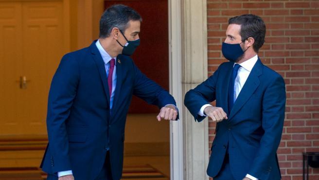 El presidente del Gobierno, Pedro Sánchez, y el presidente del PP, Pablo Casado.