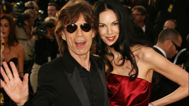 El cantante Mick Jagger y la modelo L'Wren Scott.