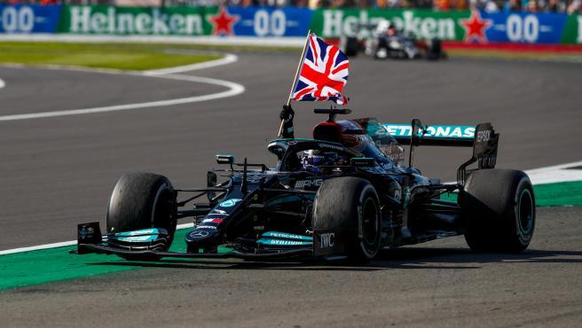 Lewis Hamilton celebrates his victory at Silverstone