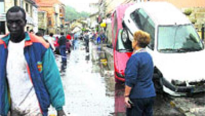 Dos turismos arrastrados por la riada, ayer, en el centro de Sabarís. (M. Vila)
