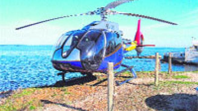Un helicóptero en la reserva marina del Cabo de San Antonio para comer en un restaurante.