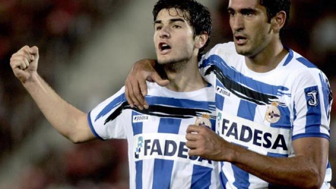 El uruguayo Taborda celebra el primer gol deportivista. (Efe)