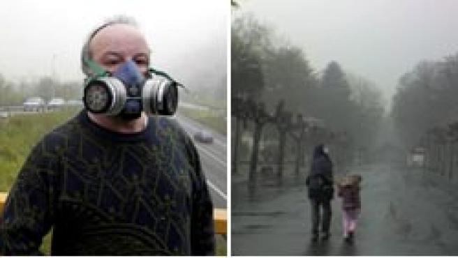 Mascarillas y calles desiertas en Langreo, tras producirse un incendio en un pozo minero (EFE/Carmen Moya).