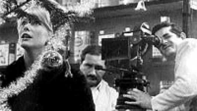 Catherine Deneuve y el director Jacques Demy, en pleno rodaje.