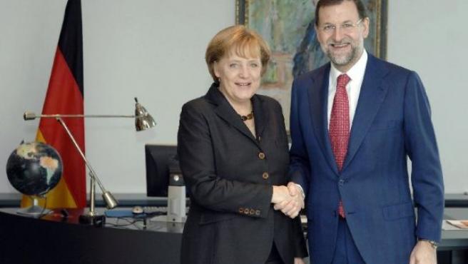 La canciller alemana, Angela Merkel, y el líder del PP, Mariano Rajoy (EFE).