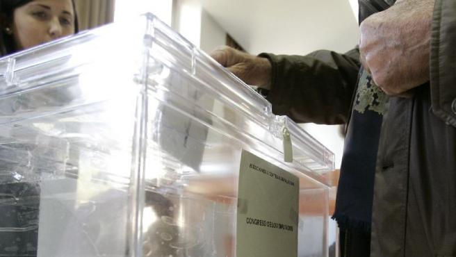A person exercises their right to vote at a polling station at the Colegio San Agustín, in Madrid.  Almost 35 million Spaniards are called to the polls to decide the composition of the Congress and Senate of the VIII legislature and the tenant of the Palacio de la Moncloa during the next four years.