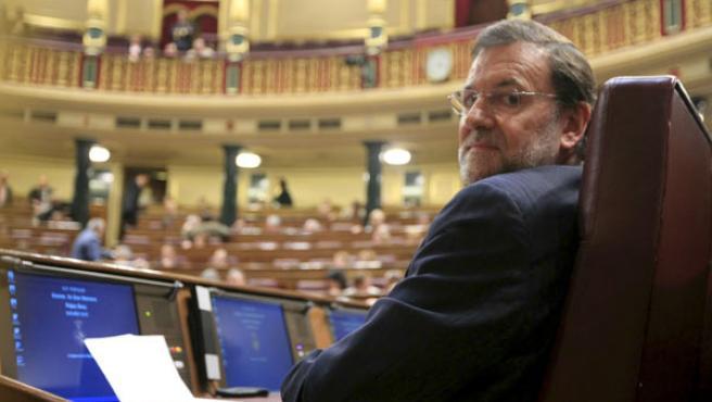 Mariano Rajoy, sentado en su escaño del Congreso. (ARCHIVO)