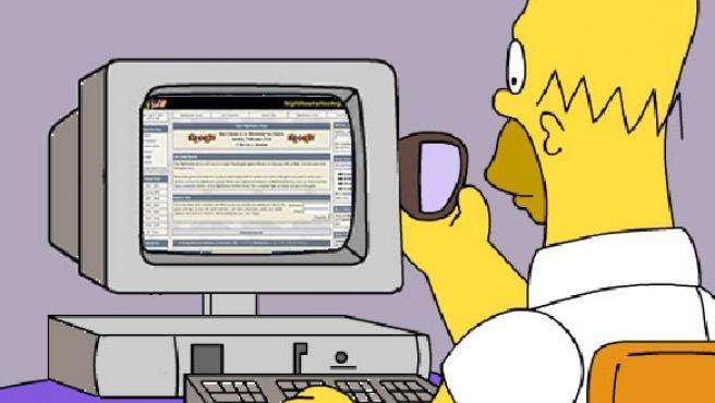 El padre la familia Simpson, ante el ordenador.