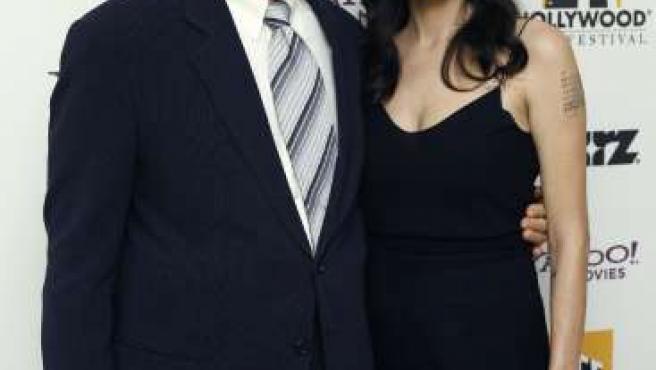 Angelina Jolie y el galardonado Clint Eastwood (REUTERS)