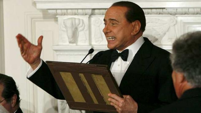Berlusconi, durante una cena en Washington con Bush (AP Photo).