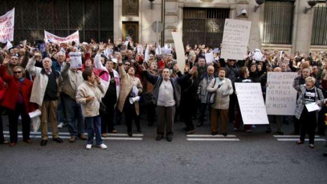 Afectados de Afinsa durante una manifestación.