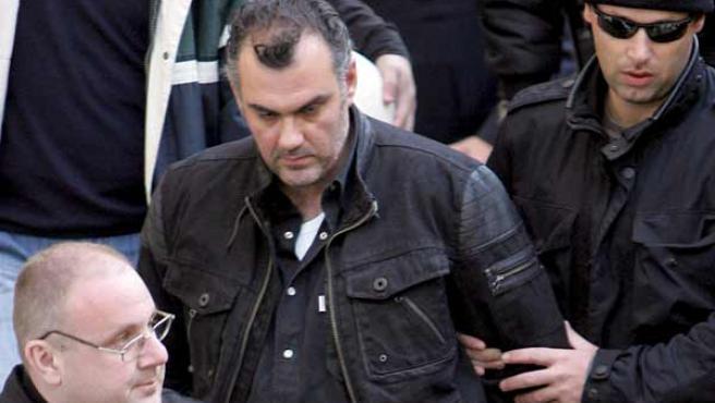 El policía griego, tras ser detenido por el asesinato del joven menor de edad.