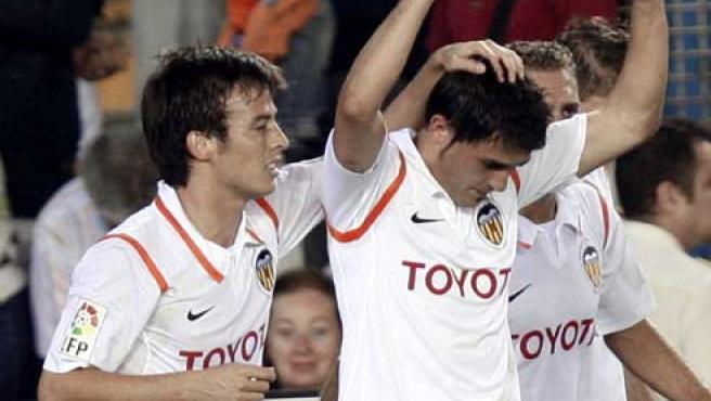 Silva y Villa celebran un gol con el Valencia (EFE).