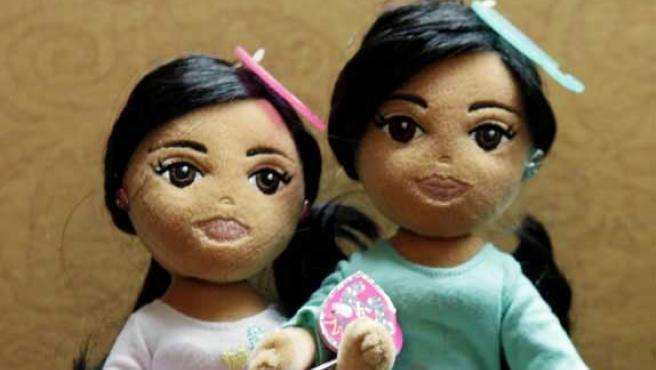 'Dulce Sasha' y 'Maravillosa Malia' son las dos muñecas que representan las dos hijas del matrimonio Obama. (LAVOZ.COM.AR)