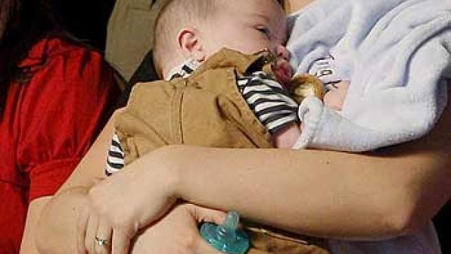 Bristol Palin, con su hijo, en un acto de campaña de su madre