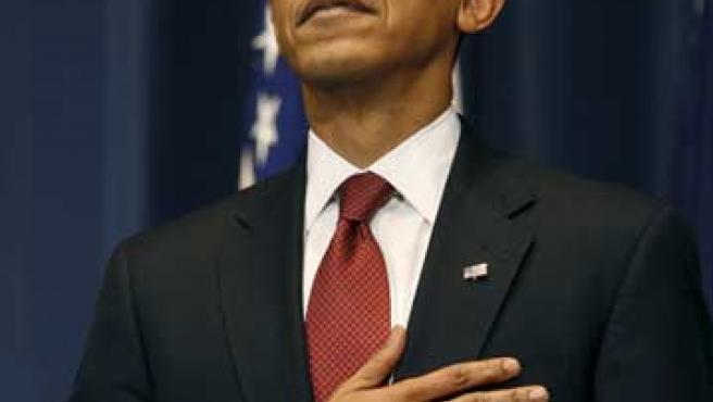 Obama, con la mano en el pecho.