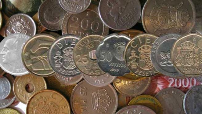 Algunas monedas de pesetas, retiradas en 2002 (AGENCIAS).
