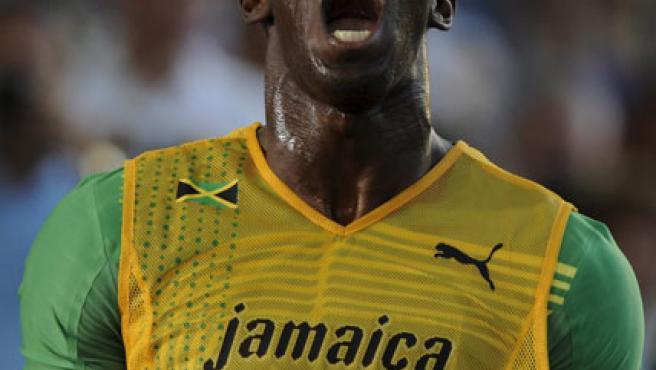 El jamaicano Usain Bolt celebra su récord del mundo en los 200 metros lisos.