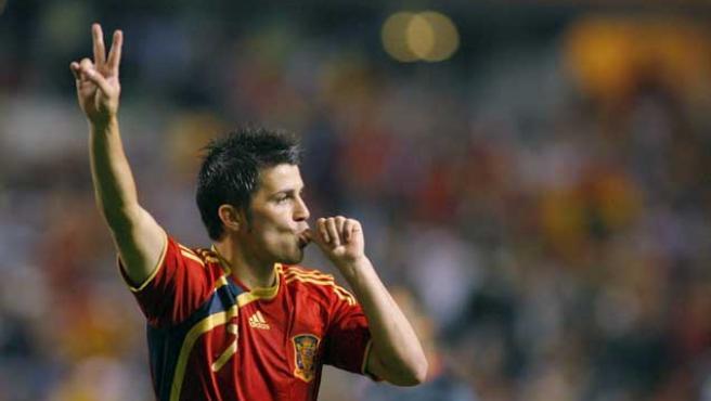 El delantero de la selección española David Villa celebra su gol, el segundo de su equipo, frente a Bélgica