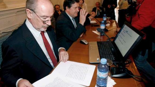 El presidente de Caja Madrid, Rodrigo Rato, junto al presidente de Bancaja, José Luis Olivas.