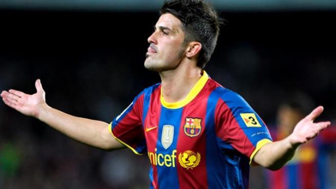 David Villa, delantero del Barcelona, celebra uno de sus goles ante el Sevilla.