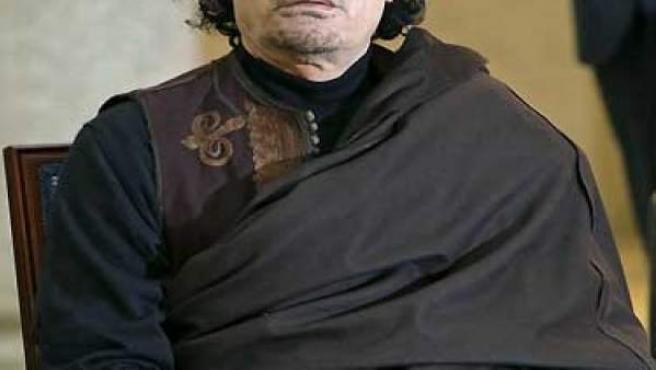 Muamar Gadafi.