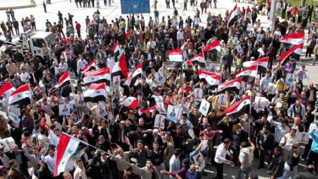 Varios seguidores del presidente sirio Bashar al-Assad.