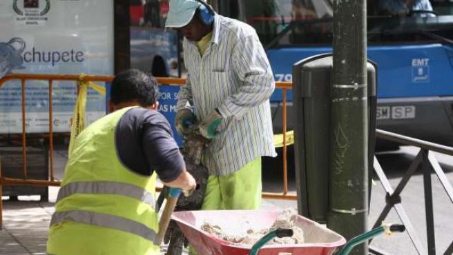 Extranjeros, inmigrantes trabajando