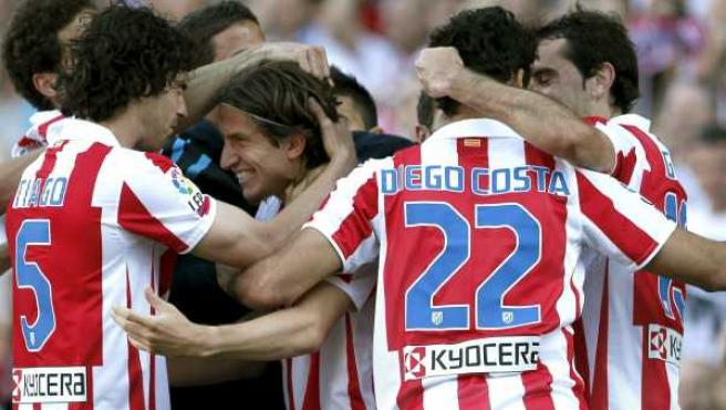 Los jugadores del Atlético de Madrid celebran uno de los goles ante la Real Sociedad.