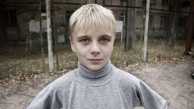 Un niño de Chernóbil retratado por Jorge López. El retrato forma parte de la exposición 'Hijos de Chernóbil' que el fotógrafo vizcaíno muestra en la galería Contraluz de Pamplona.