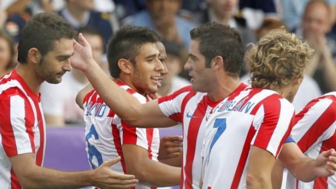 Los jugadores del Atlético de Madrid celebran uno de los tantos.