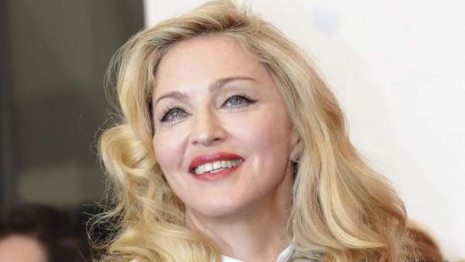 Madonna posa durante el pase gráfico de su segunda película como directora, 'W.E.', en el 68 Festival Internacional de Cine de Venecia.