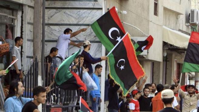 Los habitantes de la hasta ahora sitiada Sirte celebran en calles, balcones y plazas lo que parece ser el comienzo de una nueva era en el país.