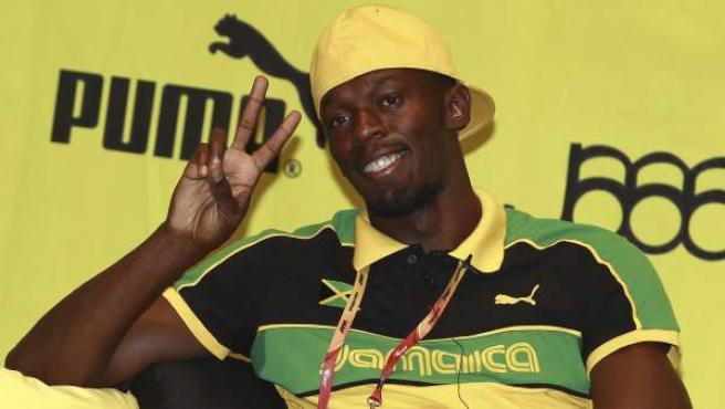 El atleta jamaicano Usain Bolt posa tras una rueda de prensa en Daegu, Corea del Sur.