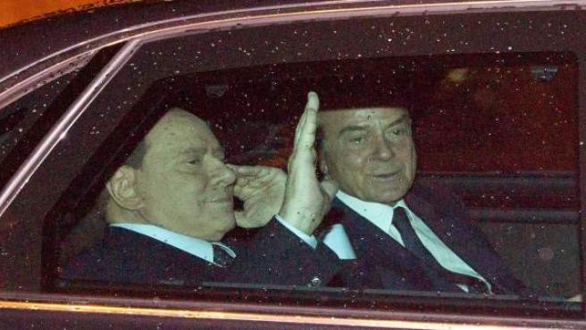 El primer ministro italiano Silvio Berlusconi sale de la reunión mantenida con el presidente de la República, Giorgio Napolitano.
