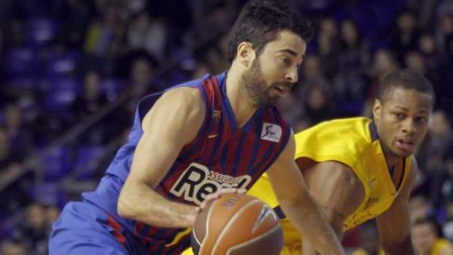 Juan Carlos Navarro, escolta del Barça Regal, penetra a canasta ante Marquez Haynes, del Gran Canaria 2014.