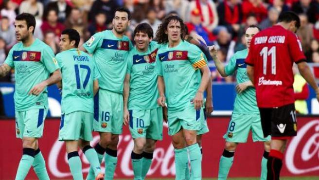 Los jugadores del Barça celebran el gol de Messi ante el Mallorca.